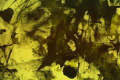 Pretty grunge yellow randomly painted canvas, fabric with color paint spots and blots texture for design purposes. Creative vintage yellow randomly painted royalty free stock images