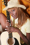 Pretty guitar player royalty free stock photo