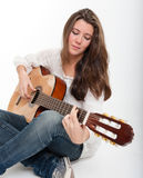 Pretty guitar player Royalty Free Stock Image