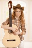 Pretty guitarplayer girl embracing guitar Royalty Free Stock Photos