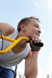Pretty guy on a bike outside Royalty Free Stock Photography