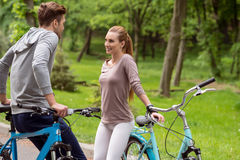 Pretty guy and girl dating with bikes Royalty Free Stock Images