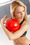 Pretty gymnast with ball Stock Photography