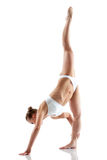 Pretty gymnast showing vertical split Stock Photography