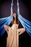 Pretty gymnast training on aerial silk. Pretty gymnast training balance on aerial silk royalty free stock photos