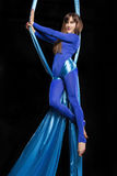 Pretty gymnast training on aerial silk. Pretty gymnast doing exercise on aerial silk royalty free stock photo