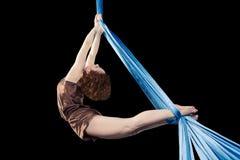 Pretty gymnast training on aerial silk. Pretty gymnast doing exercise on aerial silk stock photo
