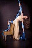 Pretty gymnast training on aerial silk. Pretty gymnast training flexibility on aerial silk stock photo