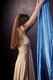 Pretty gymnast training on aerial silk. Pretty gymnast training flexibility on aerial silk stock photos
