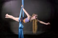 Pretty gymnast training on aerial silk. Pretty gymnast flying on aerial silk stock images