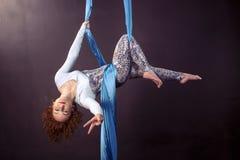 Pretty gymnast training on aerial silk. Pretty gymnast training strength on aerial silk stock images