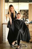 Pretty Hairdresser and Girl with Wavy Hairstyle stock photography