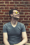 Pretty handsome young man hipster with sunglasses smiling laughi Royalty Free Stock Images