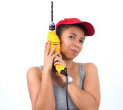 Pretty handywoman with electric drill Royalty Free Stock Images