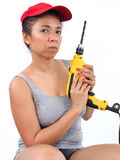 Pretty handywoman with electric drill Royalty Free Stock Photos