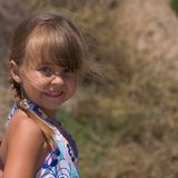 Pretty Hannah. A pretty young girl playing outside royalty free stock images