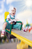 Pretty happy baby rock on swing stock image