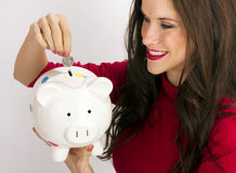 Pretty Happy Brunette Woman Drops Quarter Coin Savings Bank Royalty Free Stock Photo