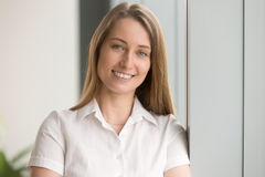 Pretty happy businesswoman looking at camera and smiling, headsh royalty free stock photos