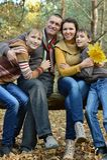Pretty happy family for a walk Stock Photos