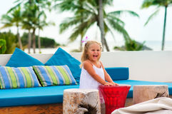 Pretty happy girl have a fun in beach cafe Stock Photography