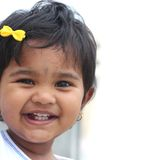 Pretty & happy indian toddler girl child smiling Stock Photography