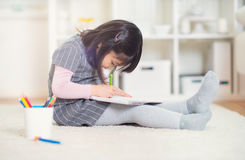 Pretty happy little japanese girl drawing with pencils at home Royalty Free Stock Photo