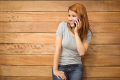 Pretty happy redhead phoning with mobile phone Royalty Free Stock Image