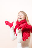 Pretty happy smiling blond woman wearing red knitted scarf and gloves Royalty Free Stock Image