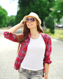Pretty happy smiling girl wearing a summer straw hat outdoors Stock Image