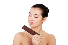 Pretty happy smiling woman eating chocolate waffle Royalty Free Stock Photos