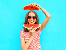 Pretty happy smiling woman is having fun with slices of watermelon Stock Photo