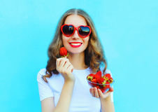 Pretty happy smiling woman with many strawberry Stock Photos