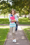 Pretty happy student carrying notebook Royalty Free Stock Photo
