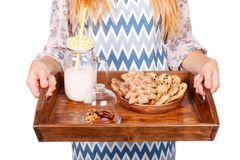 Beautiful young woman is holding a wooden tray with healthy food isolated on a white background. Food concept. royalty free stock photos