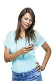 Pretty Happy Woman Holding a Mobile Phone Royalty Free Stock Photography
