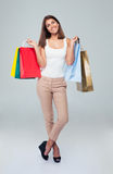 Pretty happy woman holding shopping bags Royalty Free Stock Photography