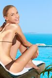 Pretty happy woman relaxing at the seaside royalty free stock image