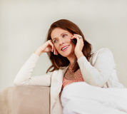 Pretty happy woman using cellphone Royalty Free Stock Images