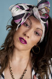 Pretty happy young female in colourful head scarf Royalty Free Stock Photos