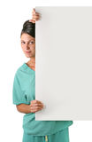 Pretty Health Care Worker Holding a Blank Sign. Health Care Worker Holding a Blank Sign for your Message on White Royalty Free Stock Images