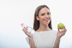 Pretty healthy girl with bottle of water and apple Royalty Free Stock Photos