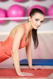 Pretty Healthy Woman Doing Push Up on the Mat Royalty Free Stock Images