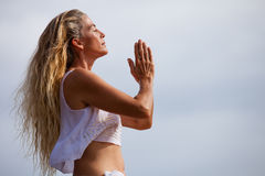 Pretty Healthy woman in her Forties Meditating Royalty Free Stock Photos