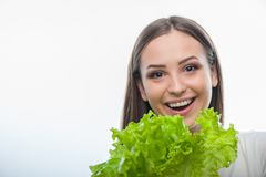 Pretty healthy woman is standing with green Royalty Free Stock Photo