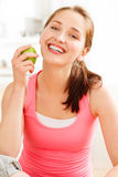 Pretty healthy young woman smiling holding a green apple Stock Image