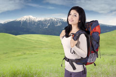 Pretty hiker with backpack on the mountain Stock Photos