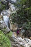 Pretty hiking girl waving hello Royalty Free Stock Photo
