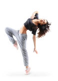 Pretty hip-hop style teenage girl jumping dancing. Pretty modern slim hip-hop style teenage girl jumping dancing isolated on a white studio background Royalty Free Stock Photo