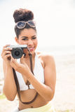 Pretty hipster in bikini taking picture Stock Photo